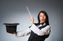 The woman magician in funny concept Stock Photography