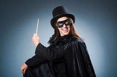 Woman magician in funny concept Royalty Free Stock Image