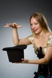 Woman magician with magic wand Stock Photo