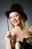 Woman magician with magic wand Stock Photography