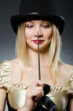 Woman magician with magic wand. And hat Royalty Free Stock Photography