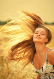 Woman with magnificent hair Royalty Free Stock Image