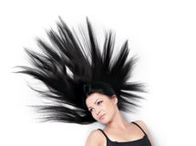 Woman with magnificent scattered hair on white Stock Photo