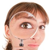 Woman and magnifier. Portrait of woman in business clothing with magnifier Stock Photo