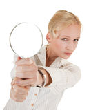 Woman and magnifier. Portrait of business woman  with magnifier in hand Royalty Free Stock Photo