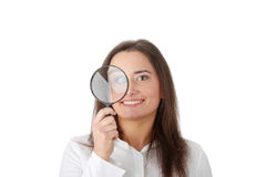 The woman with a magnifier Stock Photography