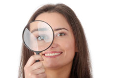 The woman with a magnifier Royalty Free Stock Photo