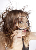WOMAN WITH MAGNIFIER Royalty Free Stock Image