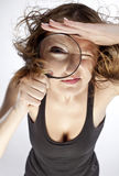 WOMAN WITH MAGNIFIER stock photo