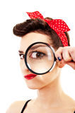 Woman with magnifier Stock Photography