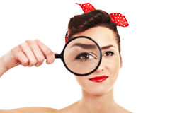Woman with magnifier Stock Photos