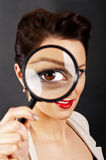Woman with magnifier Royalty Free Stock Photography