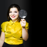Woman with magnifier doing data recovery Royalty Free Stock Photography