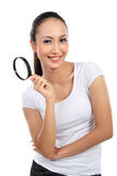 Woman with magnifier glass Stock Images