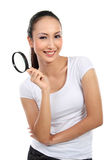 Woman with magnifier glass royalty free stock images