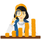 Woman with magnifier and golden coins. Stock Images