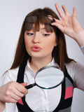 The woman with a magnifier in a hand Stock Photos