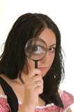 Woman with magnifier lens on eye Stock Image