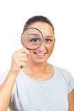 Woman magnifying eye Royalty Free Stock Image