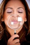 Woman with magnifying glass Royalty Free Stock Photos