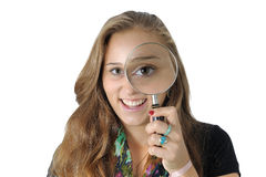 Woman magnifying glass Stock Image