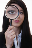 Woman with a magnifying glass Royalty Free Stock Images