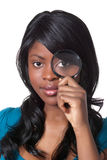 Woman with magnifying glass Stock Photos