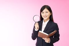 Woman with a magnifying glass. Business woman who checks the schedule Royalty Free Stock Photos