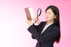 Woman with a magnifying glass. Business woman who checks the schedule Stock Image