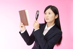 Woman with a magnifying glass. Business woman who checks the schedule Royalty Free Stock Image