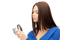 Woman with magnifying glass and euro cash money Stock Images