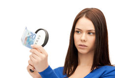 Woman with magnifying glass and euro cash money Royalty Free Stock Photos