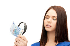 Woman with magnifying glass and euro cash money Royalty Free Stock Photography