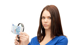 Woman with magnifying glass and euro cash money Stock Image
