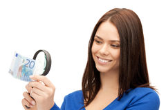 Woman with magnifying glass and euro cash money Royalty Free Stock Photo