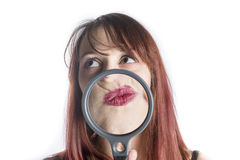 Woman with Magnifying Glass in front of Mouth Royalty Free Stock Images