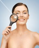 Woman with magnifying glass and laser Royalty Free Stock Photos