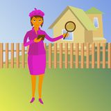 Woman with magnifying glass looking for a house Stock Photo