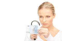 Woman with magnifying glass and money Royalty Free Stock Photography