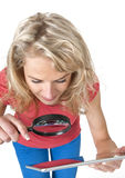 Woman with magnifying glass and tablet computer Stock Photos