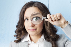 Woman with magnifying glass Royalty Free Stock Images