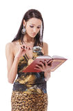 Woman through magnifying reading red book Royalty Free Stock Photos