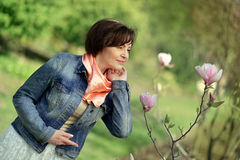 Woman and magnolia stock photography