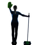 Woman maid housework brooming stop gesture silhouette Stock Photo