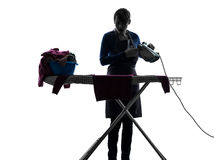 Woman maid housework ironing silhouette Royalty Free Stock Image