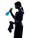 Woman maid housework sprayer silhouette Stock Images