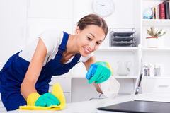 Woman maid in office Royalty Free Stock Images