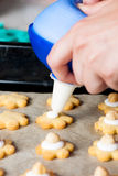 A woman maikng cookies in kitchen Stock Photos