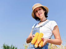 Woman with maize Royalty Free Stock Photography