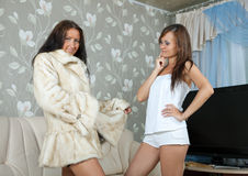 Woman  make boast of fur coat Stock Photos